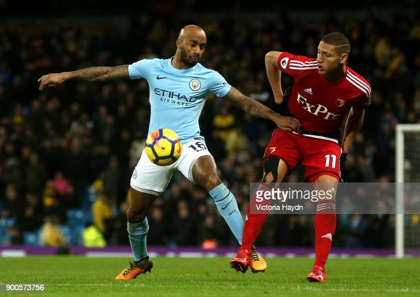 Leroy Sane of Manchester City is challenged by Richarlison de Andrade of Watford during the Premier League match between Manchester City and Watford...