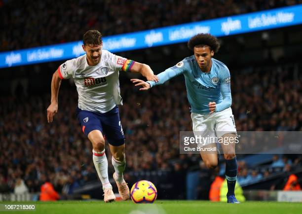 Leroy Sane of Manchester City is challenged by Simon Francis of AFC Bournemouth during the Premier League match between Manchester City and AFC...