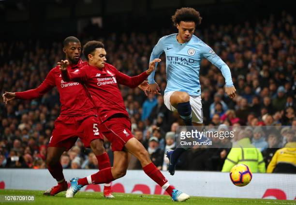 Leroy Sane of Manchester City is challenged by Trent AlexanderArnold of Liverpool and Georginio Wijnaldum of Liverpool during the Premier League...