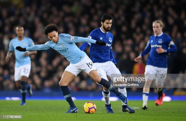 Leroy Sane of Manchester City is closed down by Andre Gomes of Everton during the Premier League match between Everton FC and Manchester City at...