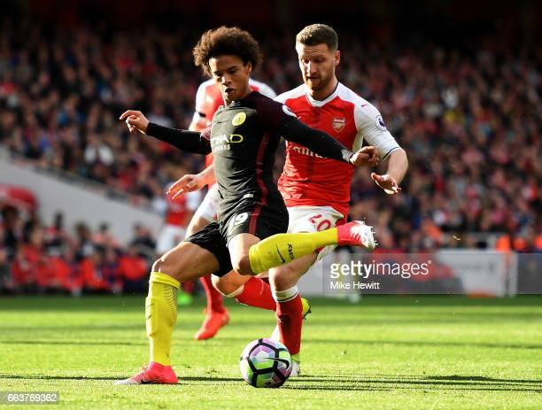 Leroy Sane of Manchester City is put under pressure from Shkodran Mustafi of Arsenal during the Premier League match between Arsenal and Manchester...