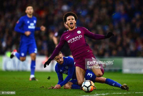 Leroy Sane of Manchester City is tackled by Joe Bennett of Cardiff City during The Emirates FA Cup Fourth Round between Cardiff City and Manchester...