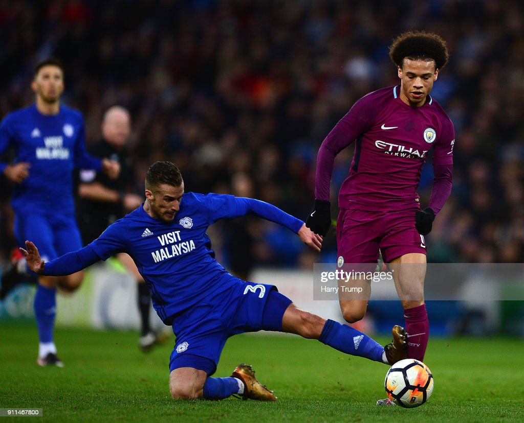 Leroy Sane of Manchester City is tackled by Joe Bennett of Cardiff City during The Emirates FA Cup Fourth Round match between Cardiff City and Manchester City at the Cardiff City Stadium on January 28, 2018 in Cardiff, United Kingdom.