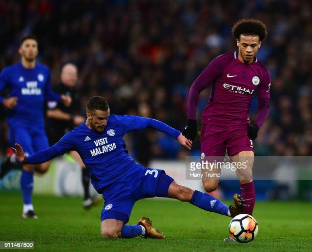 Leroy Sane of Manchester City is tackled by Joe Bennett of Cardiff City during The Emirates FA Cup Fourth Round match between Cardiff City and...