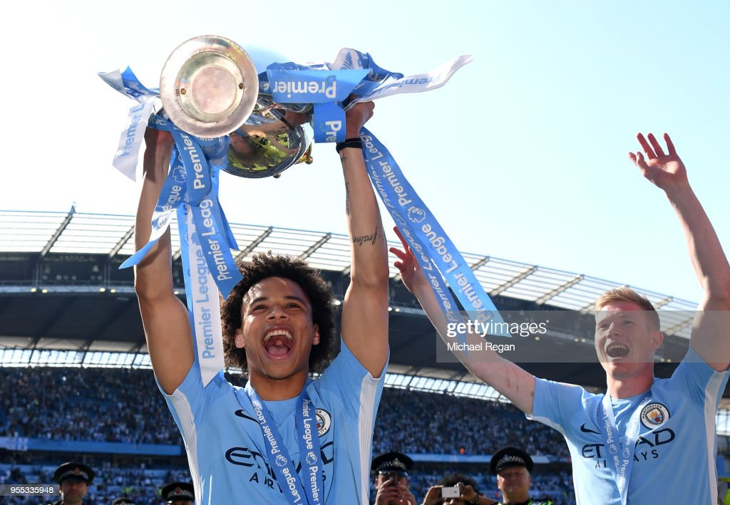 https://media.gettyimages.com/photos/leroy-sane-of-manchester-city-lifts-the-premier-league-trophy-after-picture-id955335948