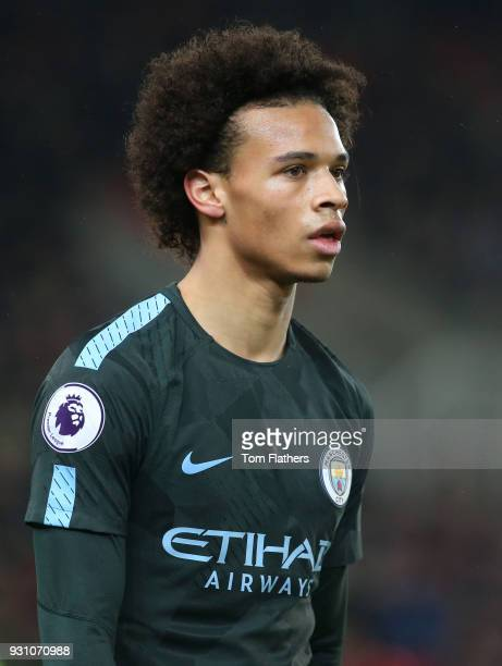 Leroy Sane of Manchester City looks on during the Premier League match between Stoke City and Manchester City at Bet365 Stadium on March 12 2018 in...