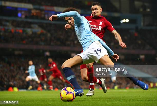 Leroy Sane of Manchester City moves away from Dejan Lovren of Liverpool during the Premier League match between Manchester City and Liverpool FC at...