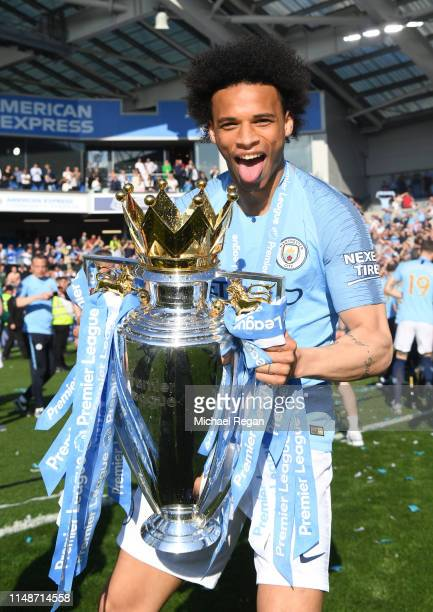 Leroy Sane of Manchester City poses with the Premier League trophy during the Premier League match between Brighton Hove Albion and Manchester City...