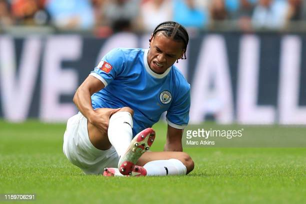 Leroy Sane of Manchester City reacts to an injury during the FA Community Shield match between Liverpool and Manchester City at Wembley Stadium on...