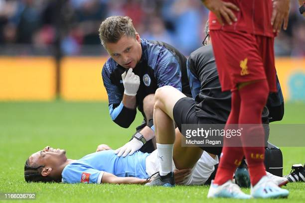 Leroy Sane of Manchester City receives medical attention during the FA Community Shield match between Liverpool and Manchester City at Wembley...