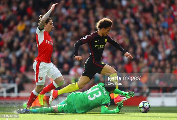 Leroy Sane of Manchester City rounds Petr Cech of Arsenal and scores his sides first goal during the Premier League match between Arsenal and...