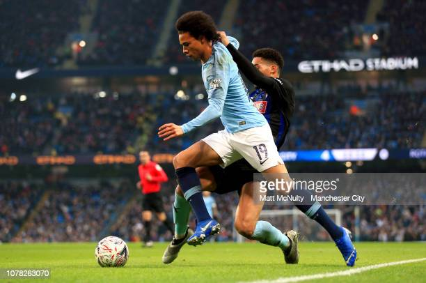 Leroy Sane of Manchester City runs with the ball during the FA Cup Third Round match between Manchester City and Rotherham United at the Etihad...