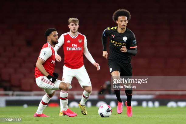 Leroy Sane of Manchester City runs with the ball under pressure from Trae Coyle of Arsenal during the Premier League 2 match between Arsenal U23 and...