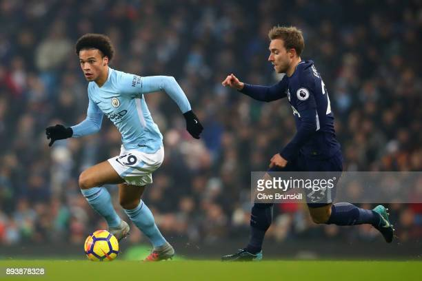 Leroy Sane of Manchester City runs with the ball while under pressure from Christian Eriksen of Tottenham Hotspur during the Premier League match...