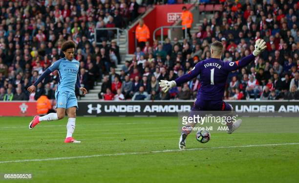 Leroy Sane of Manchester City scores a goal past Southampton goalkeeper Fraser Forster to make it 02 during the Premier League match between...