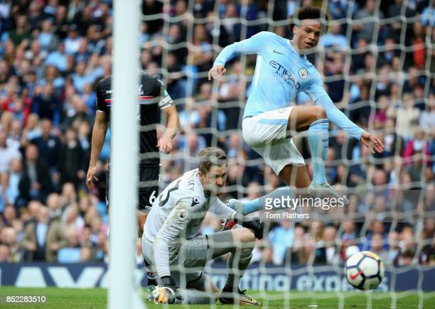 Leroy Sane of Manchester City scores his sides first goal during the Premier League match between Manchester City and Crystal Palace at Etihad...