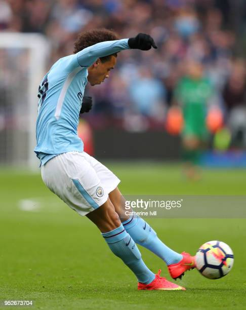 Leroy Sane of Manchester City scores his sides first goal during the Premier League match between West Ham United and Manchester City at London...