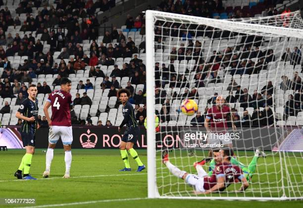 Leroy Sane of Manchester City scores his sides four goal during the Premier League match between West Ham United and Manchester City at London...