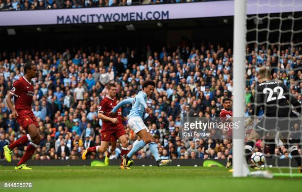 Leroy Sane of Manchester City scores his sides fourth goal past Simon Mignolet of Liverpool during the Premier League match between Manchester City...