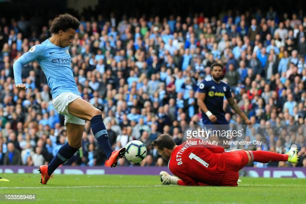 Leroy Sane of Manchester City scores his team's first goal past Marcus Bettinelli of Fulham during the Premier League match between Manchester City...