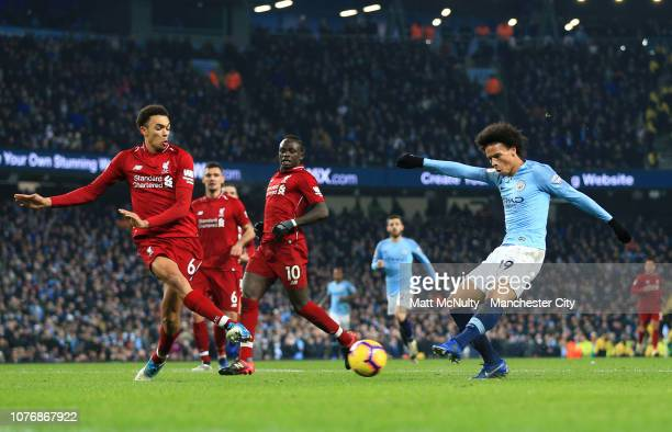 Leroy Sane of Manchester City scores his team's second goal as Trent AlexanderArnold of Liverpool attempts to block during the Premier League match...