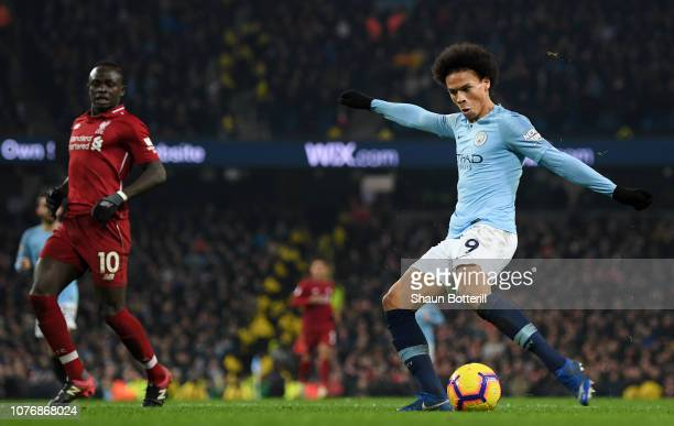 Leroy Sane of Manchester City scores his team's second goal during the Premier League match between Manchester City and Liverpool FC at the Etihad...