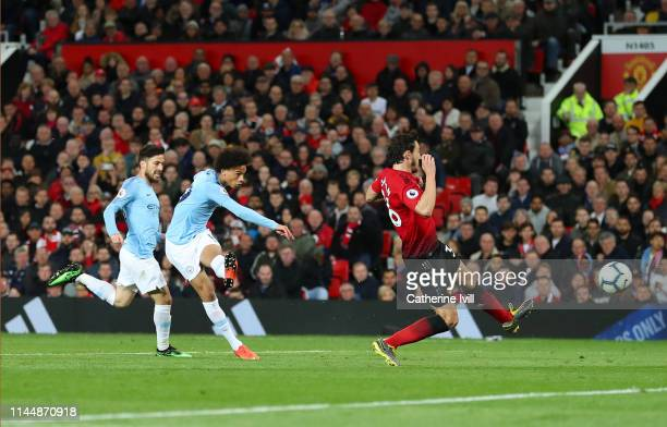 Leroy Sane of Manchester City scores his team's second goal during the Premier League match between Manchester United and Manchester City at Old...