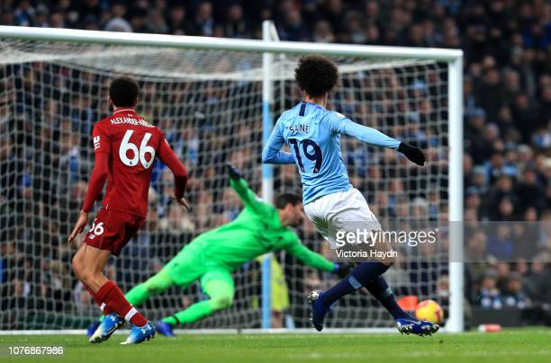 Leroy Sane of Manchester City scores his team's second goal past Alisson of Liverpool during the Premier League match between Manchester City and...