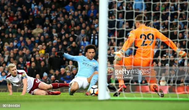 Leroy Sane of Manchester City scores his team's third goal during The Emirates FA Cup Third Round match between Manchester City and Burnley at Etihad...