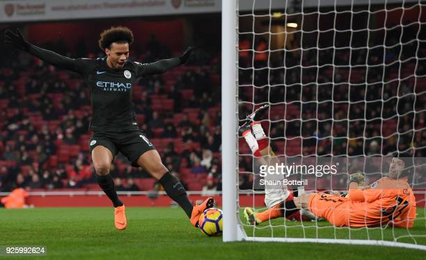 Leroy Sane of Manchester City scores the third goal past Petr Cech of Arsenal during the Premier League match between Arsenal and Manchester City at...