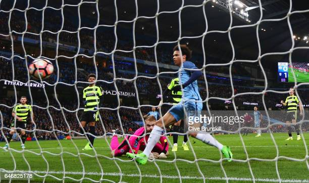 Leroy Sane of Manchester City scores their first goal during The Emirates FA Cup Fifth Round Replay match between Manchester City and Huddersfield...