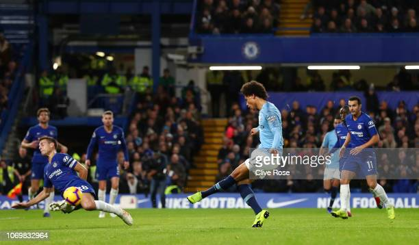 Leroy Sane of Manchester City shoots and Cesar Azpilicueta of Chelsea blocks during the Premier League match between Chelsea FC and Manchester City...