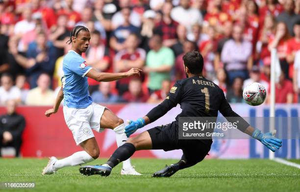 Leroy Sane of Manchester City shoots as he is closed down by Alisson Becker of Liverpool during the FA Community Shield match between Liverpool and...