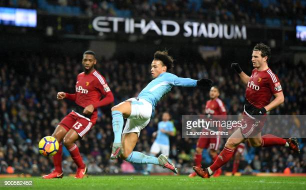 Leroy Sane of Manchester City shoots during the Premier League match between Manchester City and Watford at Etihad Stadium on January 2 2018 in...