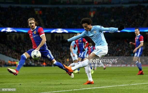 Leroy Sane of Manchester City shoots past Michael Lang of Basel during the UEFA Champions League Round of 16 Second Leg match between Manchester City...