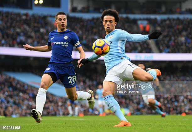 Leroy Sane of Manchester City shoots whilst under pressure from Cesar Azpilicueta of Chelsea during the Premier League match between Manchester City...