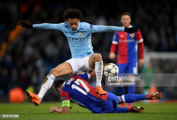 Leroy Sane of Manchester City skips over the challenge of Marek Suchy of FC Basel during the UEFA Champions League Round of 16 Second Leg match...