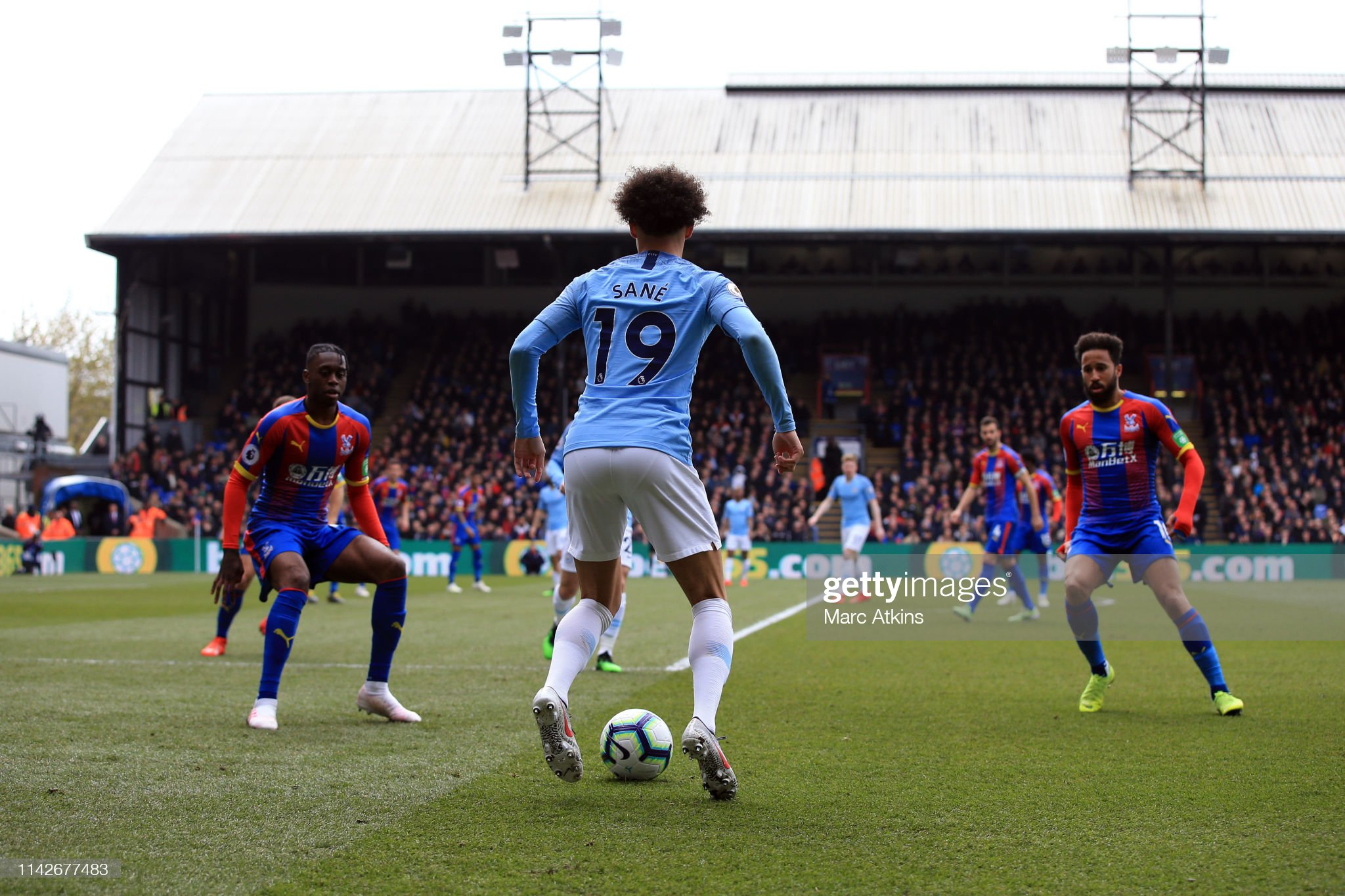 https://media.gettyimages.com/photos/leroy-sane-of-manchester-city-takes-on-the-palace-defenders-during-picture-id1142677483?s=2048x2048