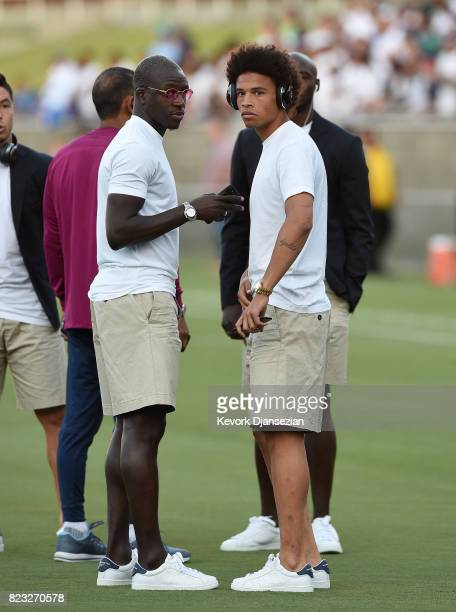 Leroy Sane of Manchester City talks with new defender Benjamin Mendy during warm ups before the game against Real Madrid during the International...