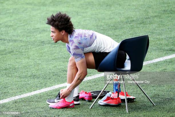 Leroy Sane of Manchester City ties his boots during the training session at Manchester City Football Academy on June 01 2020 in Manchester England