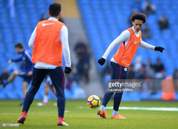 Leroy Sane of Manchester City warms up ahead of the Premier League match between Manchester City and Chelsea at Etihad Stadium on March 4 2018 in...
