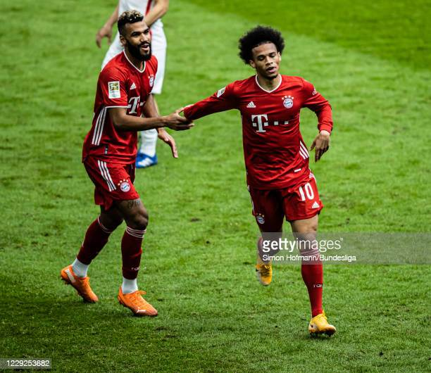Leroy Sane of Muenchen celebrates a goal with team mate Eric Maxim ChoupoMoting of Muenchen during the Bundesliga match between FC Bayern Muenchen...