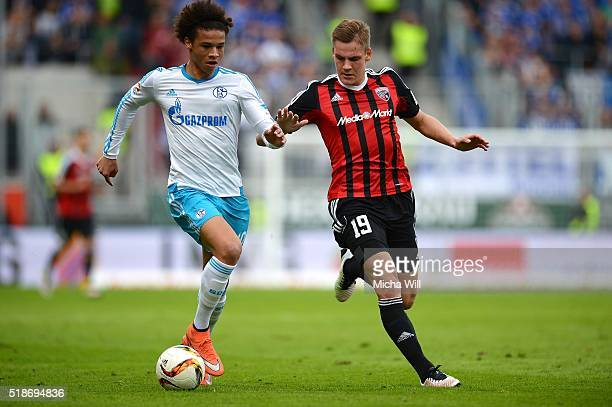 Leroy Sane of Schalke is challenged by Max Christiansen of Ingolstadt during the Bundesliga match between FC Ingolstadt and FC Schalke 04 at Audi...