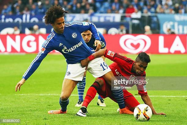 Leroy Sane of Schalke is challenged by Wendell of Leverkusen during the Bundesliga match between FC Schalke 04 and Bayer Leverkusen at VeltinsArena...