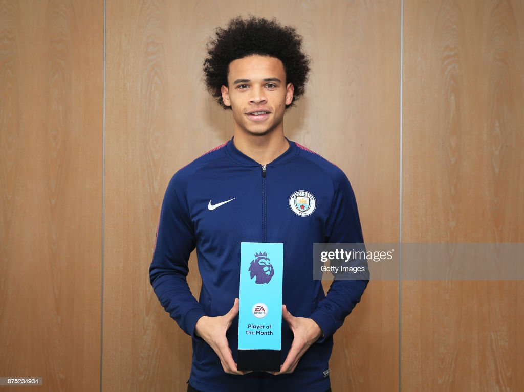 Leroy Sane poses with his EA SPORTS Player of the Month award for October at Manchester City Football Academy on November 16, 2017 in Manchester, England.