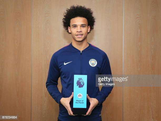 Leroy Sane poses with his EA SPORTS Player of the Month award for October at Manchester City Football Academy on November 16 2017 in Manchester...