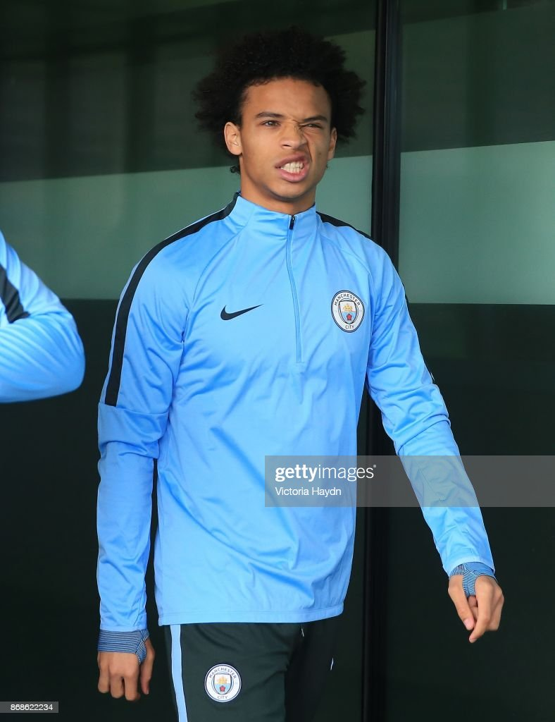 Leroy Sane reacts walking to training at Manchester City Football Academy on October 31, 2017 in Manchester, England.