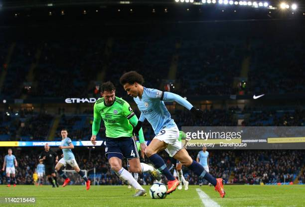 Leroy Sane takes on of Manchester City Sean Morrison of Cardiff City during the Premier League match between Manchester City and Cardiff City at...