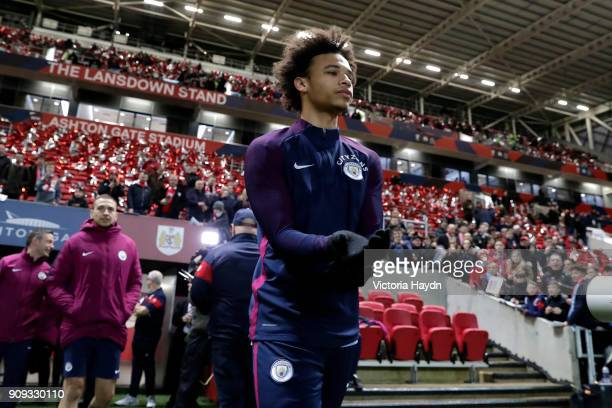 Leroy Saneof Manchester City walks onto the pitch prior to the Carabao Cup semifinal second leg match between Bristol City and Manchester City at...