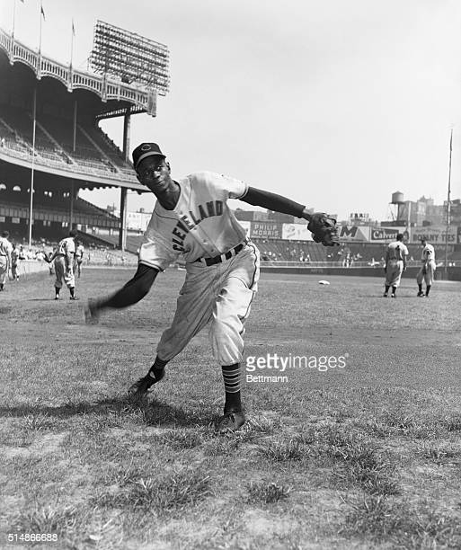 "Leroy ""Satchel"" Paige, a star pitcher in the Negro Leagues for many years, pitches during warmups for the Cleveland Indians. Paige became the first..."